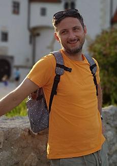 Man in yellow t-shirt smiling