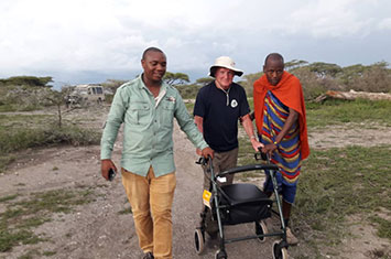 Reduced mobility person with 2 guides in Tanzania