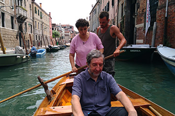 Three people in a venice boat