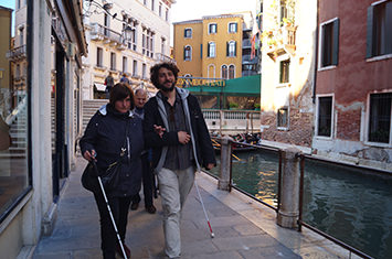 Two people walking through venice