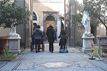 Wheelchairs in typical Italian city
