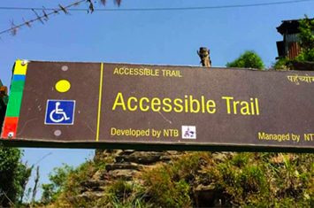 Direction sign with wheelchair sign
